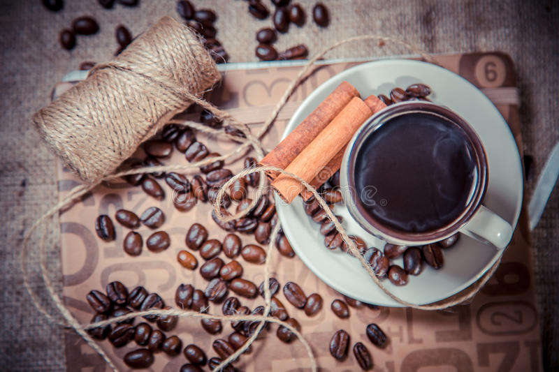 Cup of black coffee on a notebook, coffee royalty free stock images