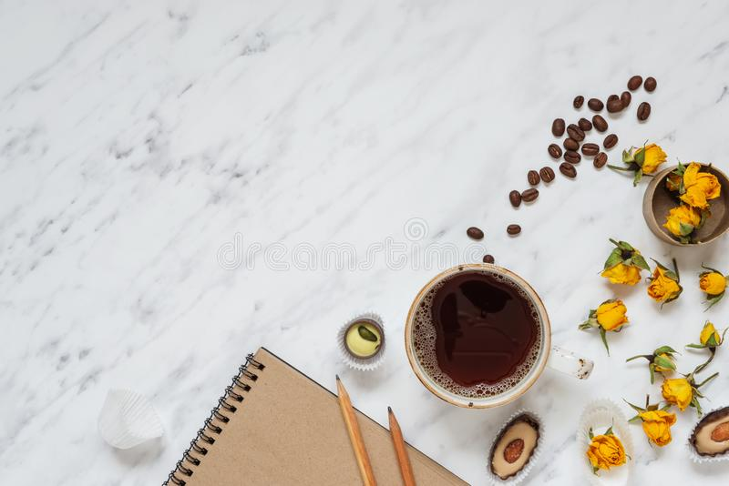 Cup of black coffee and a notebook stock image