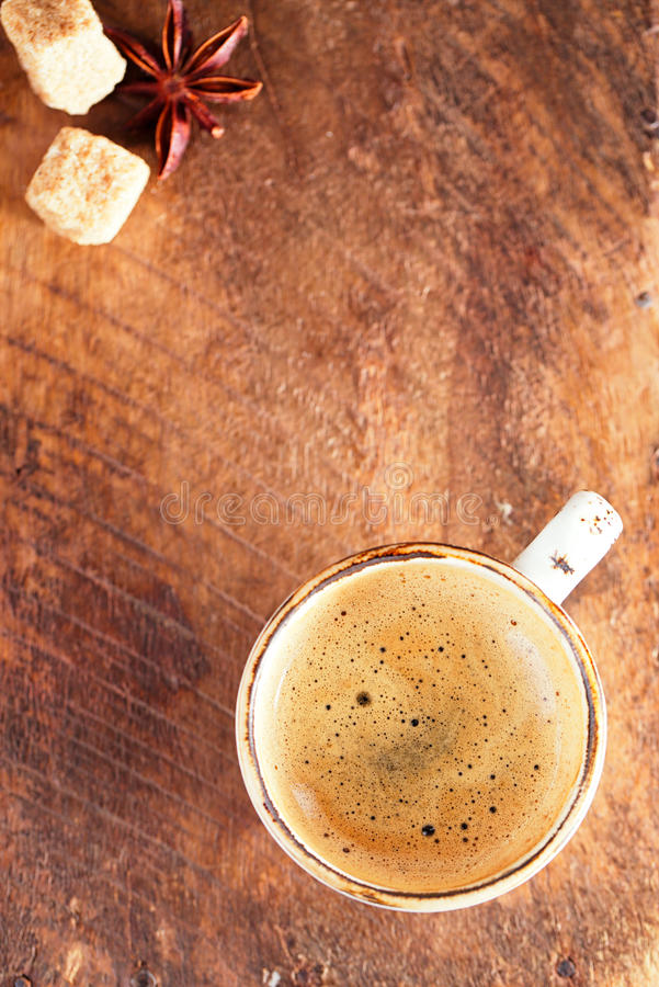 A cup of black coffee on old textured wood stock image