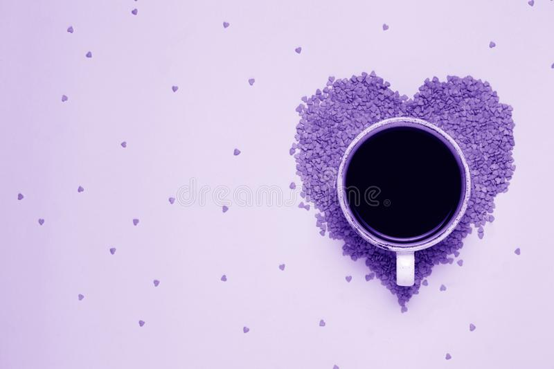 Cup of black coffee and pink hearts in ultraviolet style. St valentine`s day concept, woman`s day. top view, flat lay. stock images