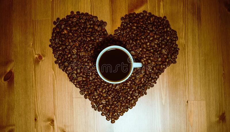 A cup black coffee on the table with coffee beans royalty free stock photos