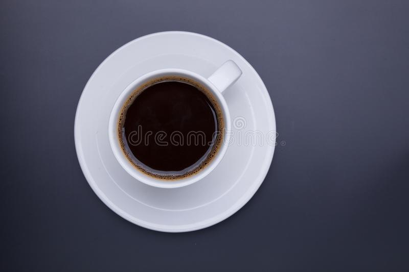 Cup of black coffee on table top view, flat lay, mock up. Cup of royalty free stock photography