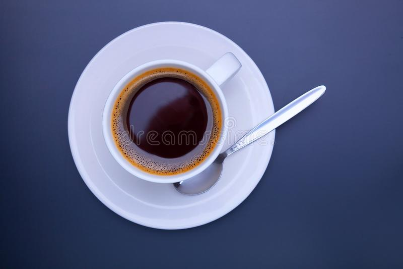 Cup of black coffee on table top view, flat lay, mock up. Cup of stock photos
