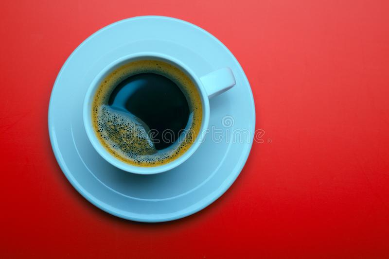 Cup of black coffee on table top view, flat lay, mock up. Cup of royalty free stock image