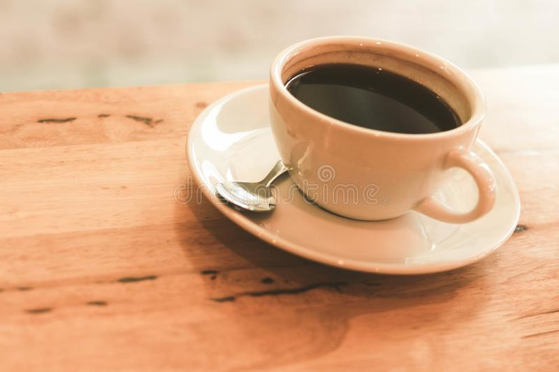Cup of black coffee on wood table royalty free stock images