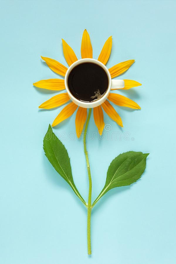 Cup of black coffee and yellow petals stalk flower shaped. Creative Flat lay Top view Copy space. Concept good morning. Cup of black coffee and yellow petals stock images