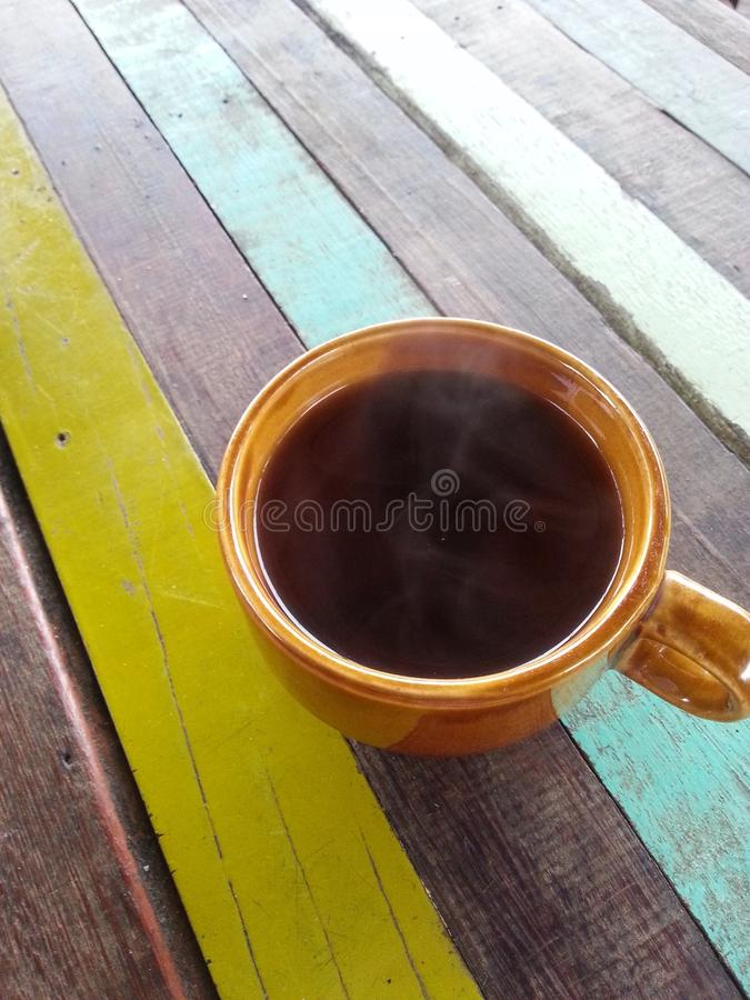 a cup of black on a colorful table stock image
