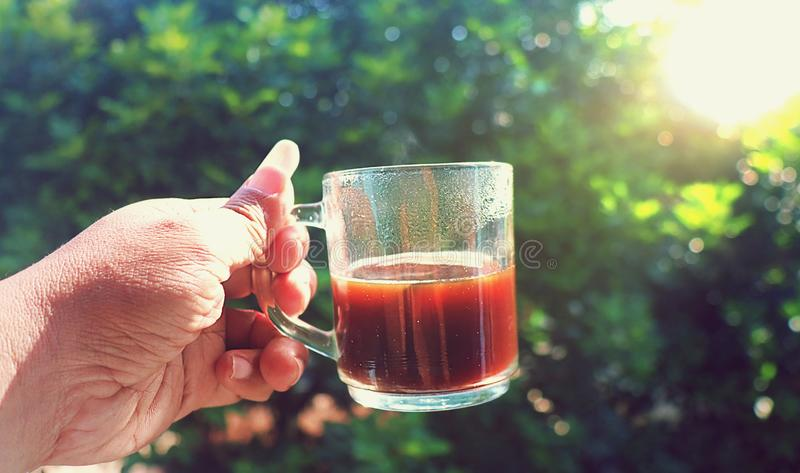 A cup of black hot java coffe in the morning stock image