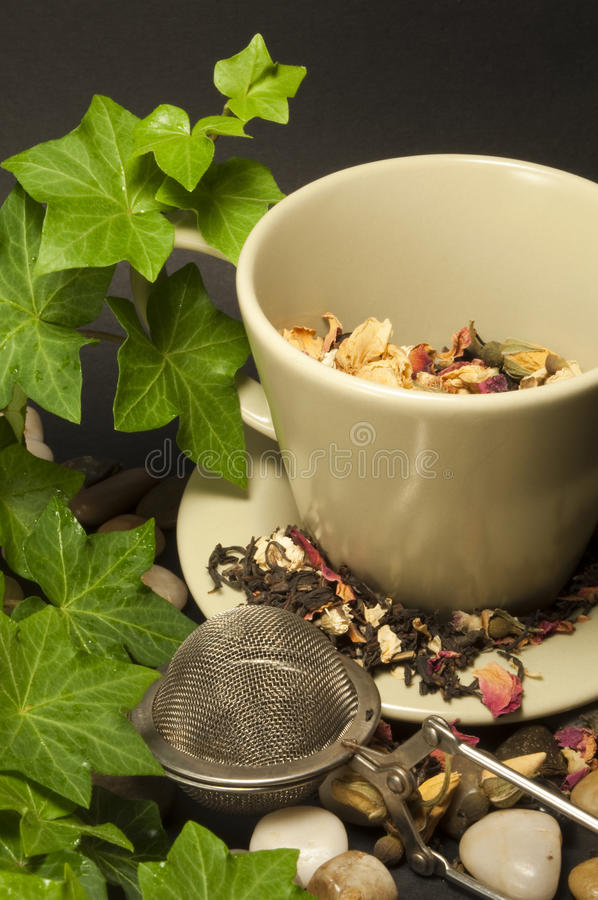 Cup of black tea. Cup of black hot tea with flowers royalty free stock photography