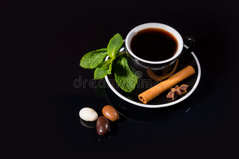 Cup of black tea with candy and flavorings royalty free stock photos