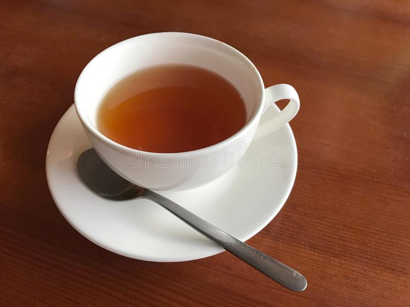 Cup with black tea on a wooden table royalty free stock images