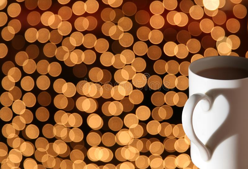 Cup on bokeh lights stock image