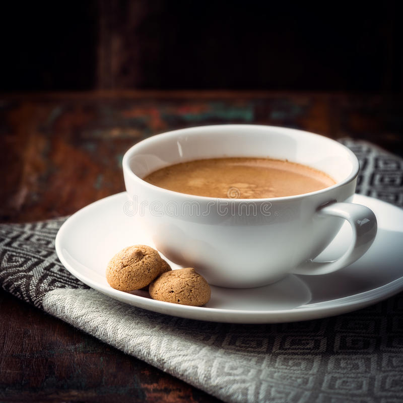 Cup of Caffe Crema. With biscotti royalty free stock images