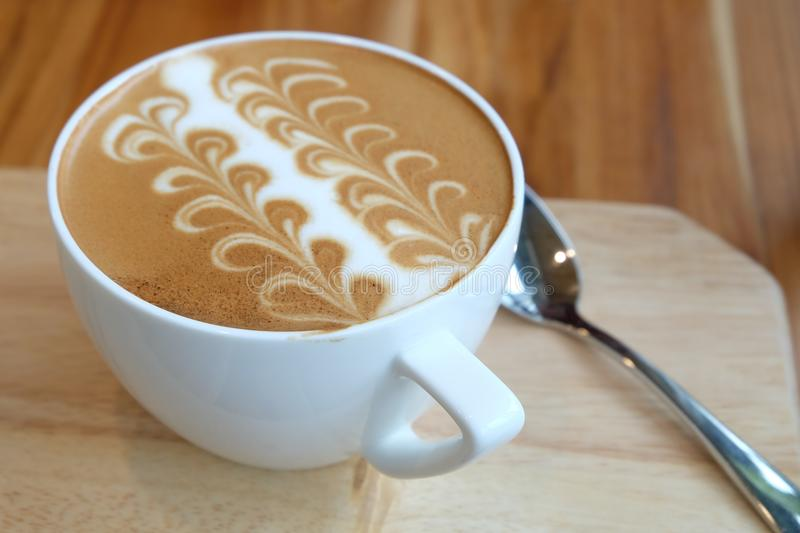 A cup of Caffe Latte Art royalty free stock images