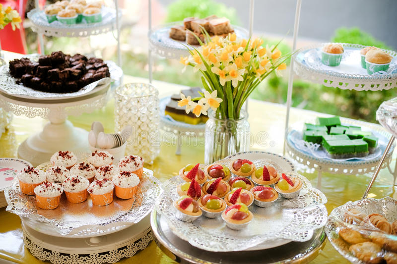 Cup Cake Booth. Cake and cupcake prepared to serve visitors at wedding. The Cupcake Booth that aims to spread happiness amongst children and youth through fresh stock image