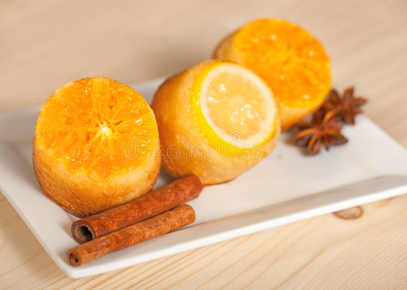 Cup-cake close-up topped with citrus. Vivid citrus cupcakes on a white plate stock images