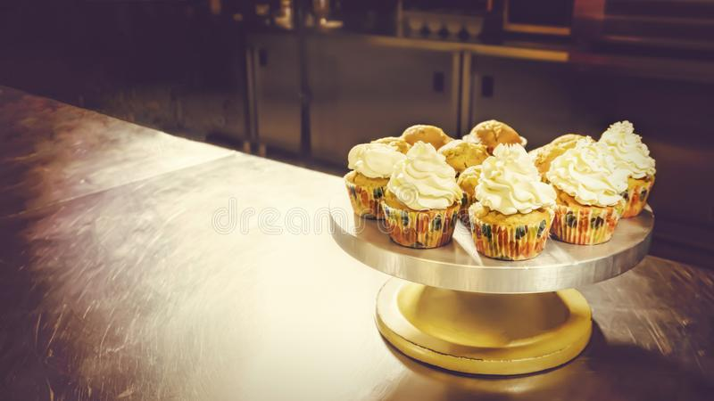 Cup cakes on cake stand, pastry-shop, sweet-shop. Delicious cup cakes on cake stand, pastry-shop, sweet-shop confectioner shop, copy space royalty free stock images