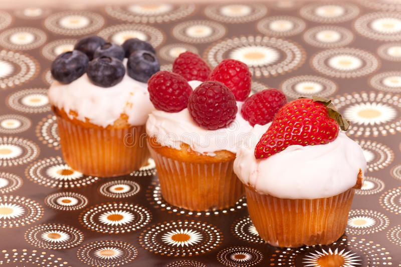 Cup cakes with fruits stock photo