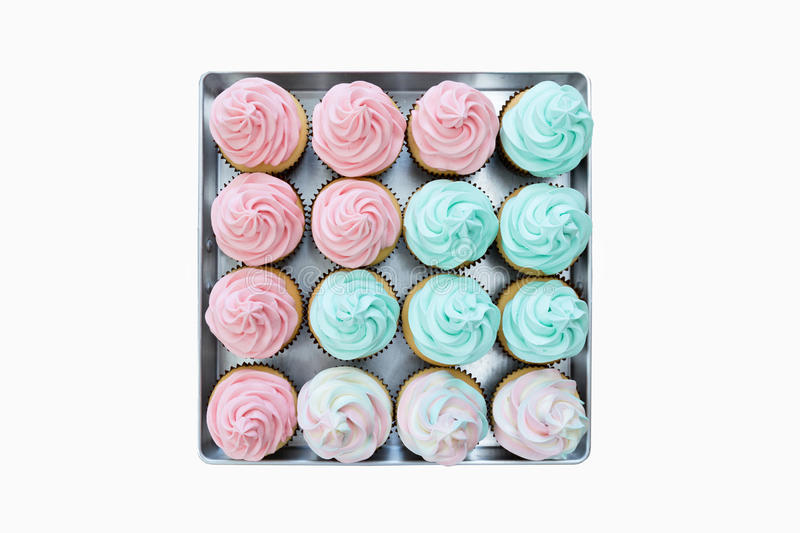 Cup cakes still in a tray on isolated white background. royalty free stock photography