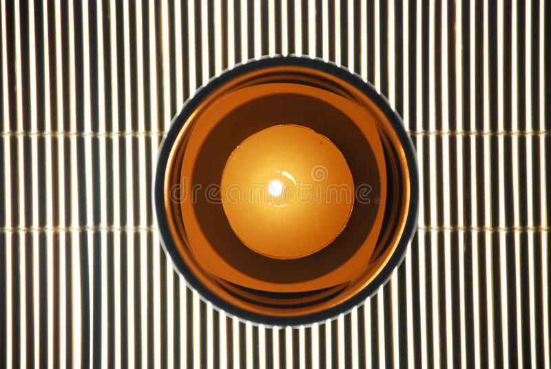 Download Cup Candles On Bamboo Blinds Stock Image - Image: 21647431