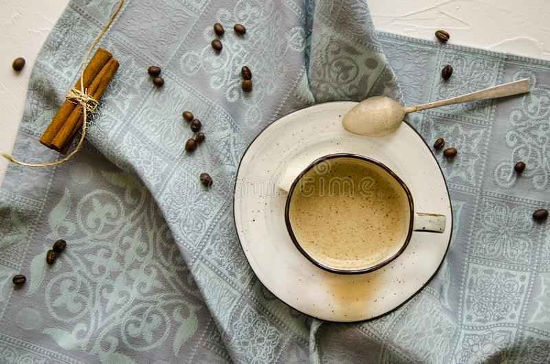 A cup of cappuccino with cinnamon royalty free stock photo