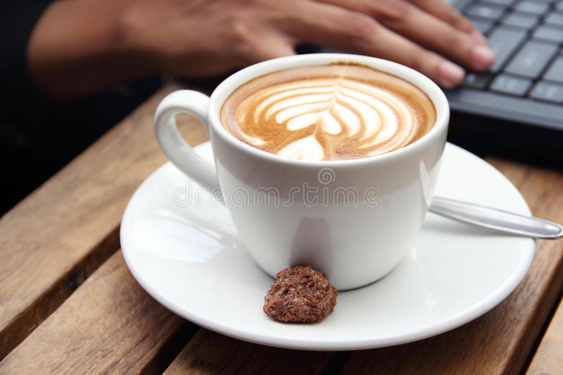 A cup of cappuccino close up. Close up shot of a cappuccino served in a cup. Urban business people lifestyle concept stock image