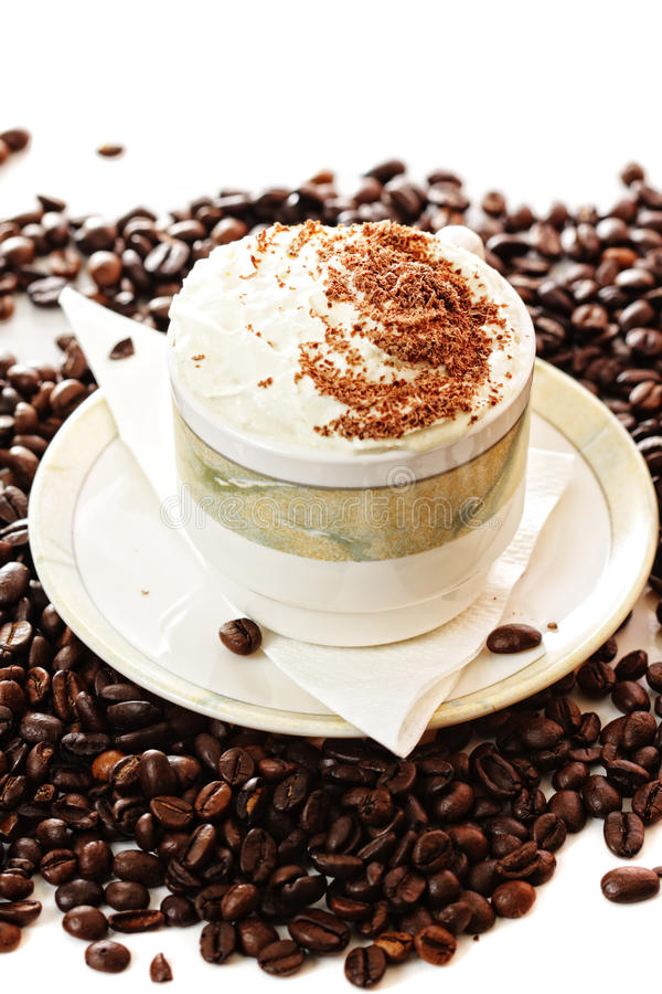 Cup Of Cappuccino Coffee On Beans Royalty Free Stock Photos