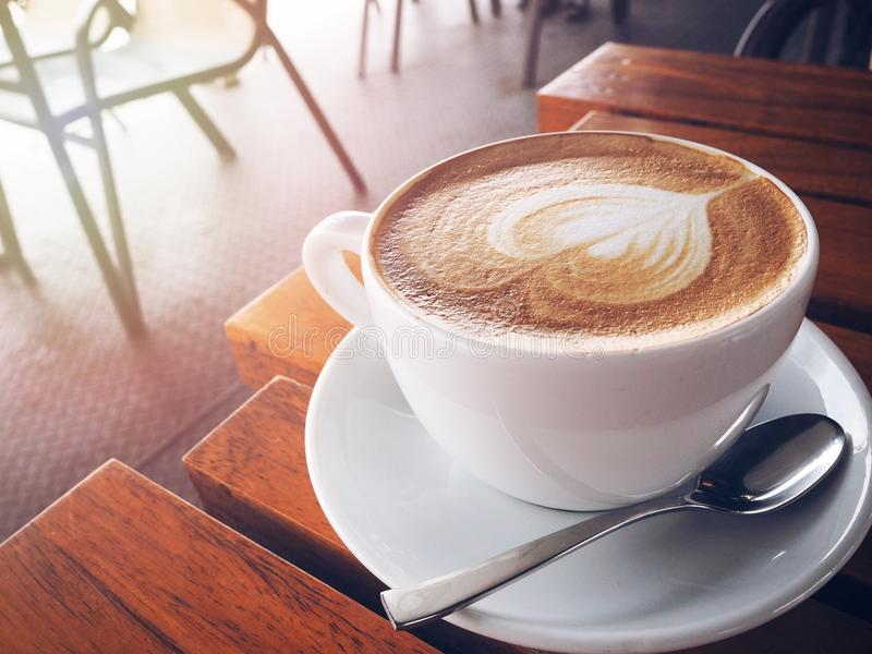 A cup of cappuccino coffee royalty free stock photo