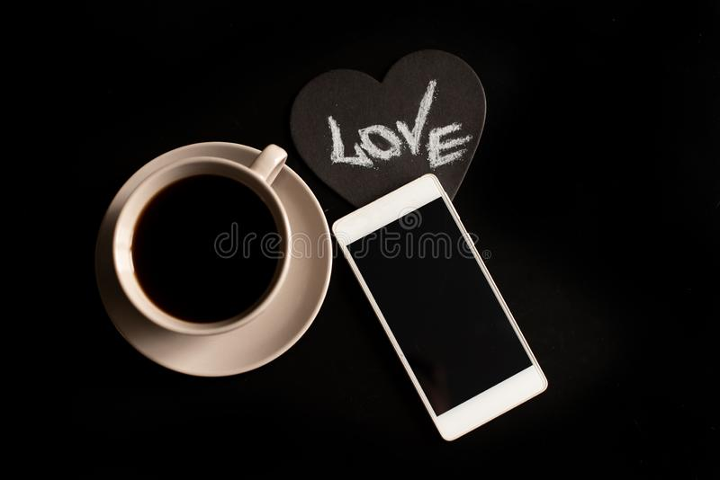 Cup of cappuccino coffee with the word love on milk froth.  stock image