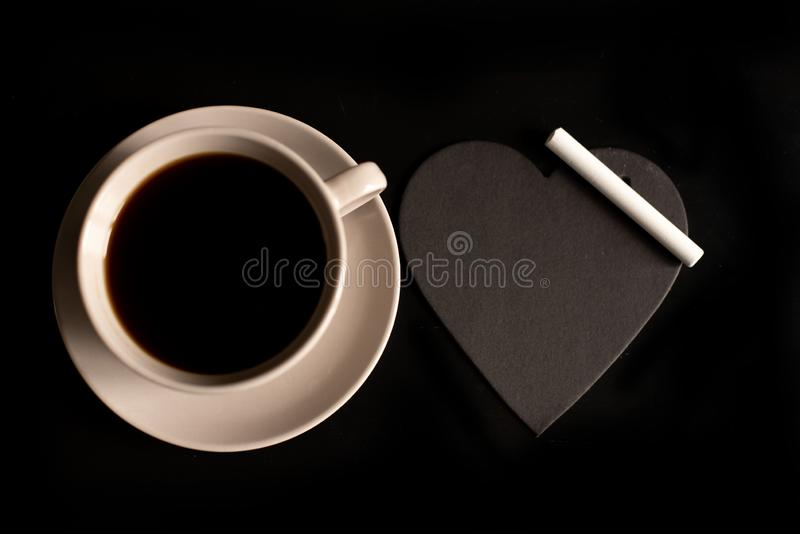 Cup of cappuccino coffee with the word love on milk froth.  royalty free stock photo