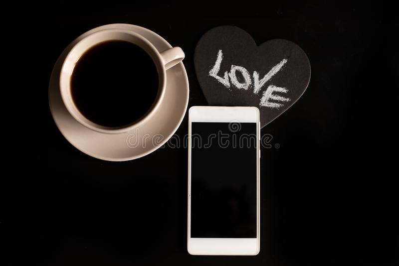 Cup of cappuccino coffee with the word love on milk froth.  royalty free stock image