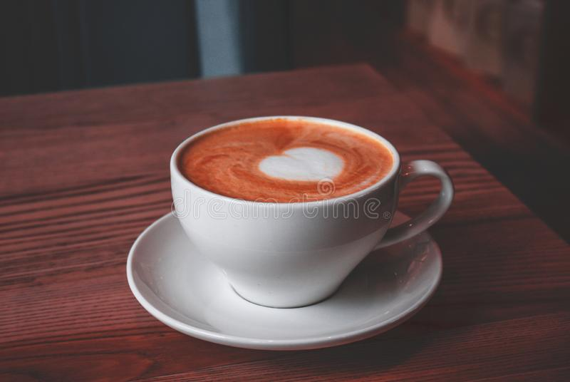 Cup of cappuccino with love art stock image