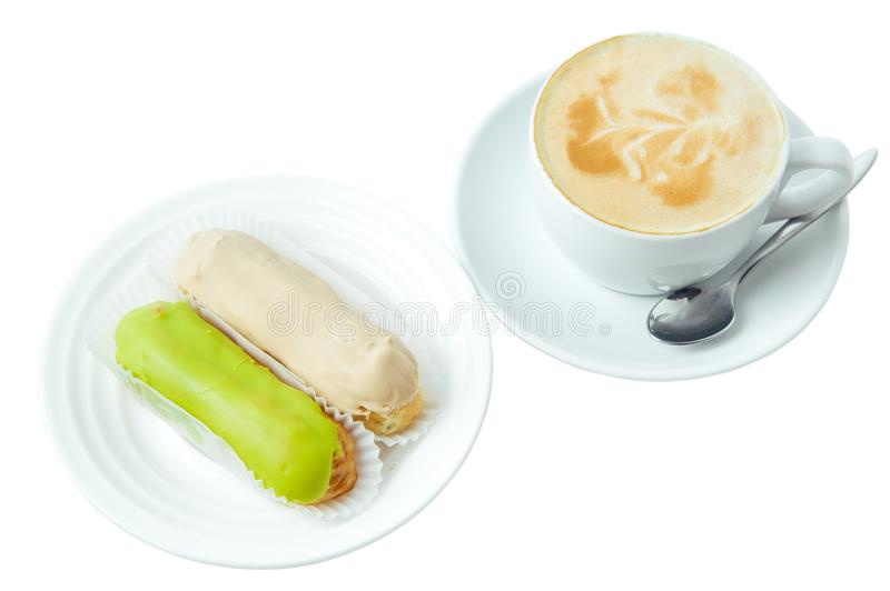 Cup of cappuccino and two eclair isolated on white background royalty free stock image