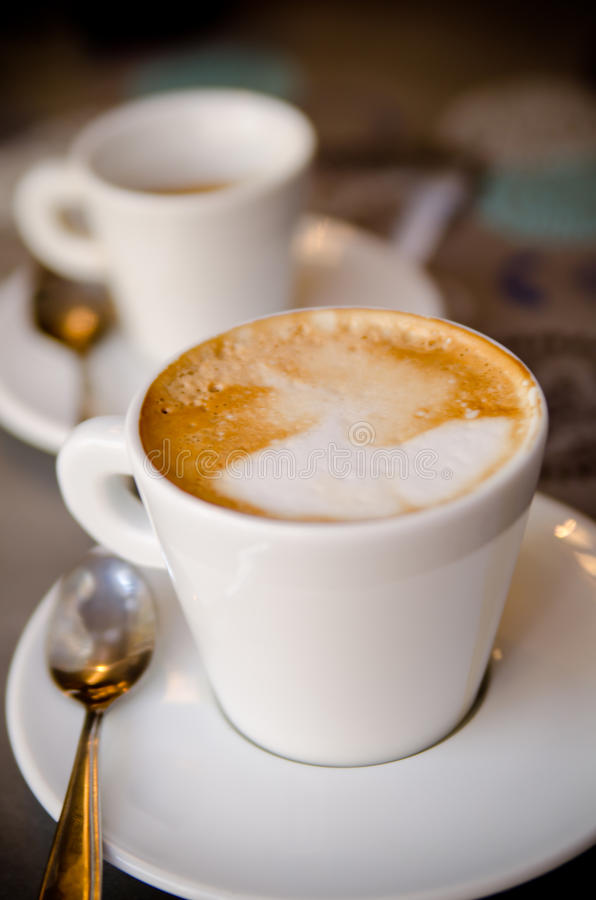 A cup of cappucino. A close up of cup of cappucino royalty free stock image