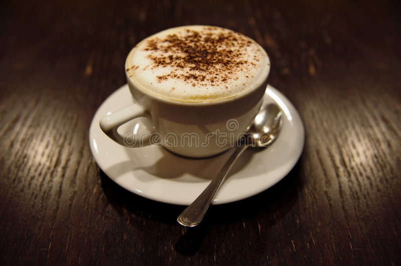 Cup of cappucino. (toned in sepia royalty free stock image