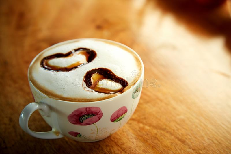 Cup cappucino with heart shaped. Cup of coffee cappucino with heart-shaped decoration stock image