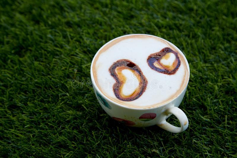 Cup cappucino with heart shaped. Cup of coffee cappucino with heart-shaped decoration stock photography