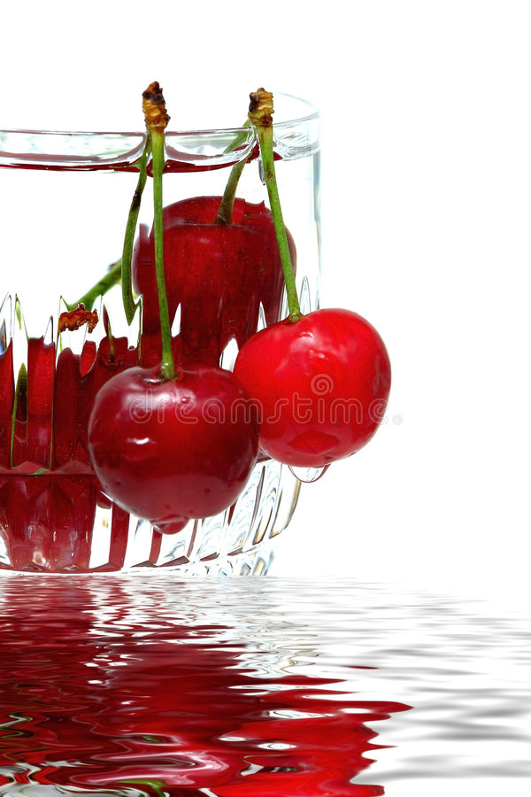 Cup of cherries royalty free stock photography