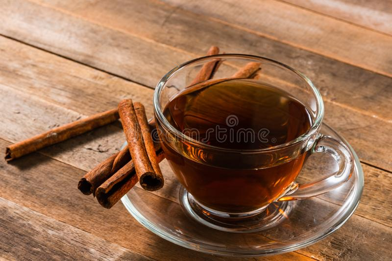 A cup of cinnamon tea. On wooden table royalty free stock photography