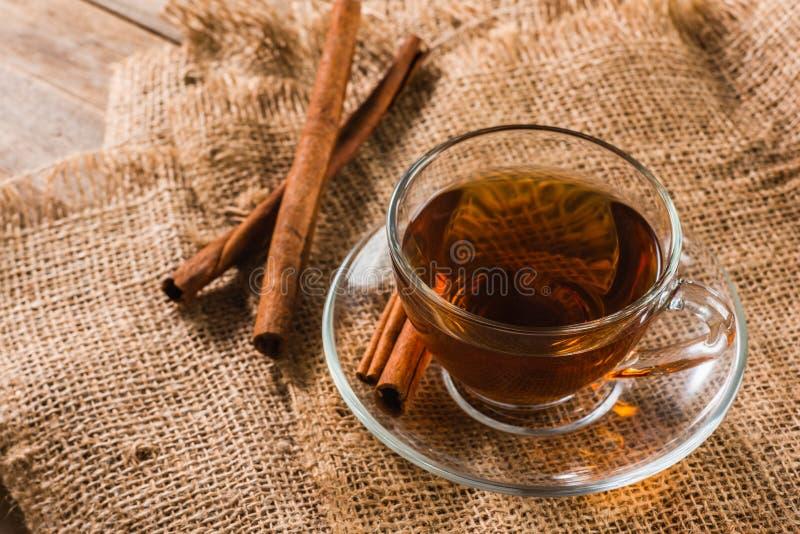 A cup of cinnamon tea. On sackcloth stock photo