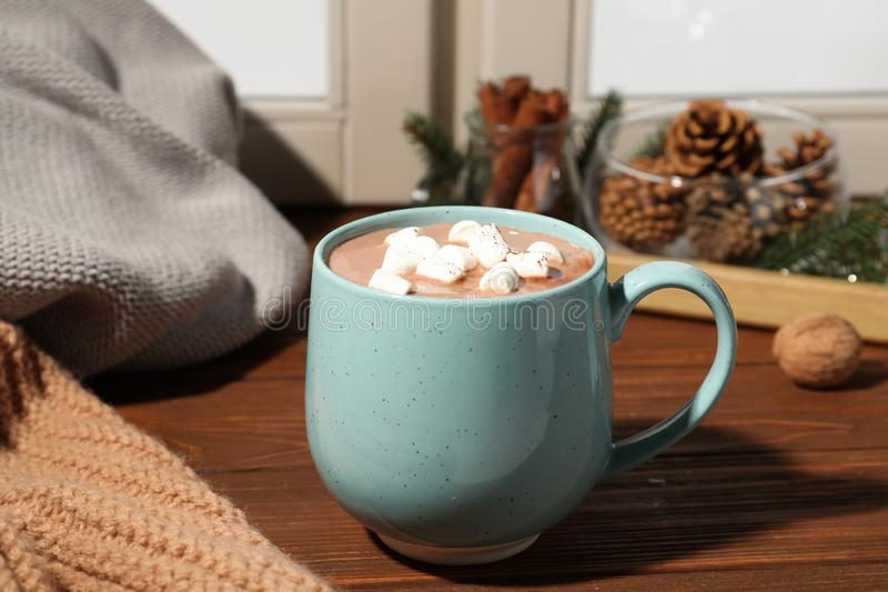 Cup of cocoa with marshmallows on windowsill. Winter drink. Cup of cocoa with marshmallows on windowsill indoors. Winter drink royalty free stock photography