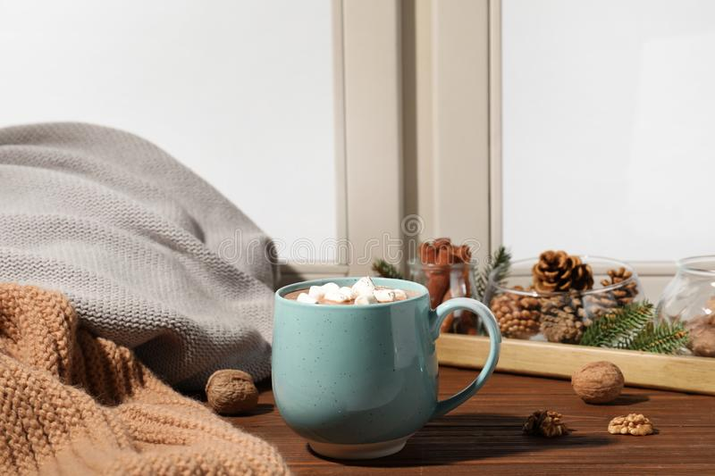 Cup of cocoa on windowsill, space for text. Winter drink. Cup of cocoa on windowsill indoors, space for text. Winter drink stock photo