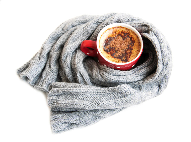 Cup of cocoa wrapped in grey scarf. On a white background stock photos