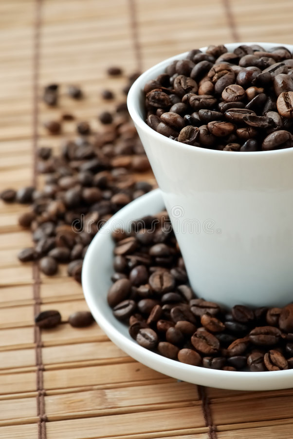 Cup with coffe beans royalty free stock photo