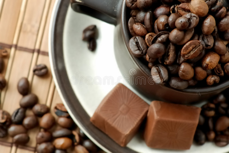 Cup with coffe beans stock photography