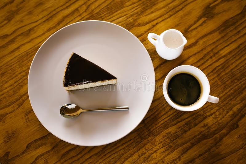 Cup of coffe, milk and cheesecake stock photo