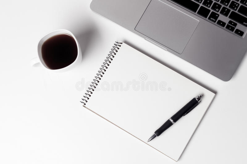 Cup With Coffe And Notebook With Pen Near Laptop. At Working Space royalty free stock image