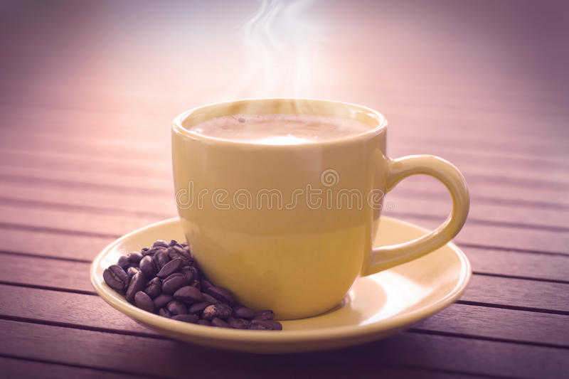 Cup of coffe. Over wooden table royalty free stock photo