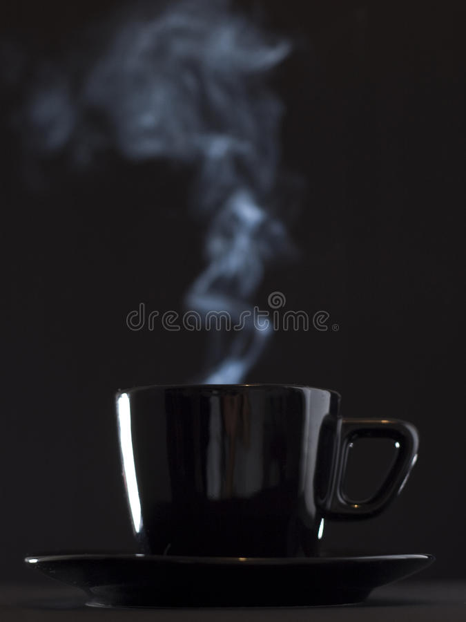 Cup of coffee. On a dark background stock images
