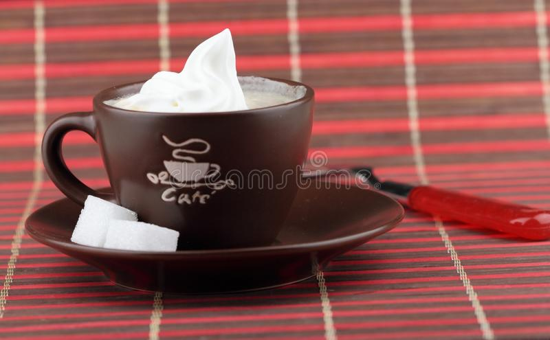 Cup of coffee. With two lump of sugar and whipped cream royalty free stock photo